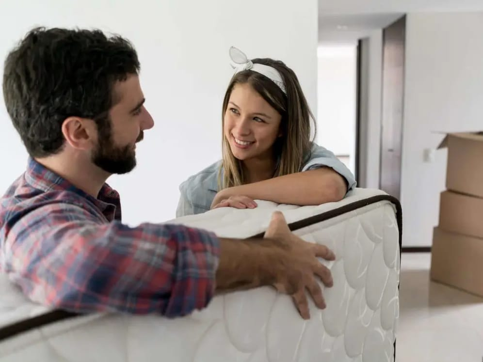 A couple who have just purchased a new mattress