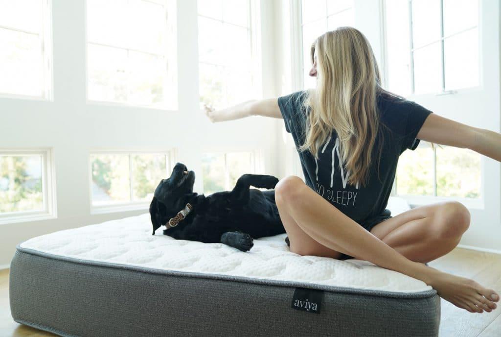 aviya mattress woman and a dog