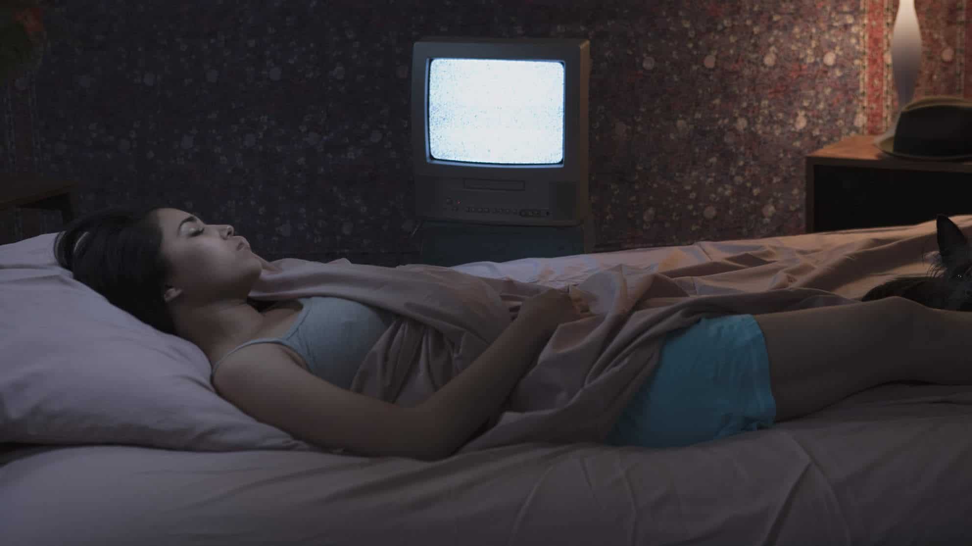 Woman sleeping with television on