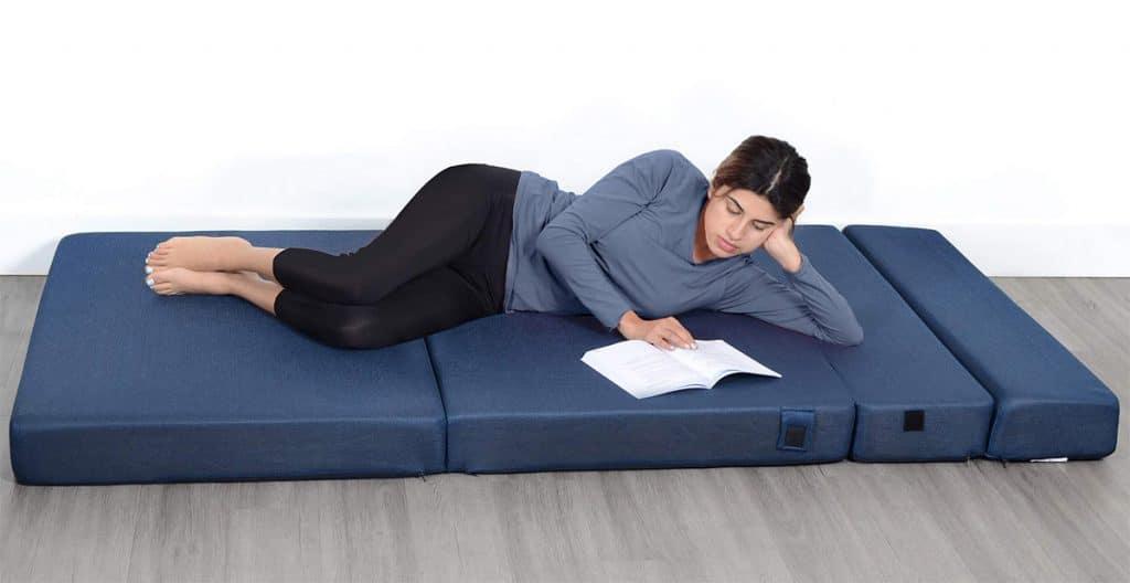 Reading book on a folding mattress
